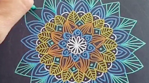This mandala creation is oddly mesmerizing