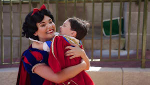 Boy has sweet interactions with Disney princesses