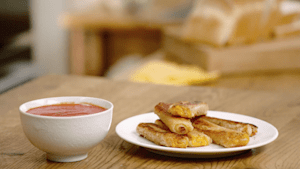 Grilled cheese roll-ups with tomato soup