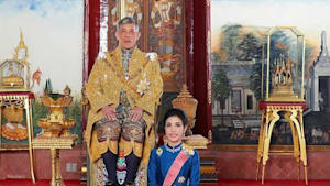 Thai King strips royal titles from consort, accused of plotting against the queen to take her place