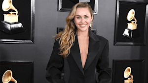 Miley Cyrus clarifies remark after saying she thought she had to be gay