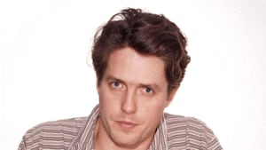 Hugh Grant shuts trolls down first by posting his infamous 1995 mug shot