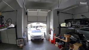 Car's Wing Door Collides With Garage's Wall While Woman Tries Parking it Inside