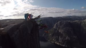 20 daredevils leap off of cliff in epic base jump