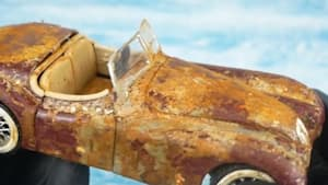Rusty toy car is refurbished to mint condition