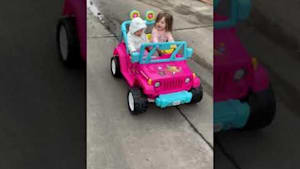 Little girl drives her toy Jeep hilariously
