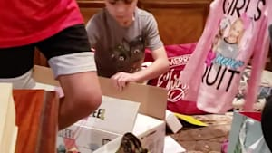Kid reacts to unwrapping empty gift box