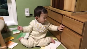 Toddler finds a surprise hiding in the drawer
