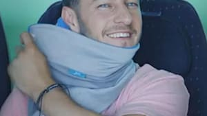 Sleep easy sitting up with this wrap-around travel pillow