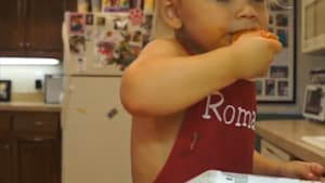 Cute boy makes own pizza, covers it in toppings