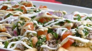 Dip into these crispy Mediterranean nachos