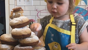Make tasty donuts with this talented two-year-old