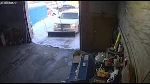 Man Falls Back Trying to Close Overhead Garage Door as Strap Breaks
