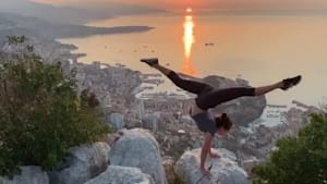 Girl Does Amazing Handstand While Rotating Legs on Cliff