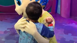 Disney character shares moment with deaf child