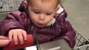 Little girl is mesmerized by tools in the store