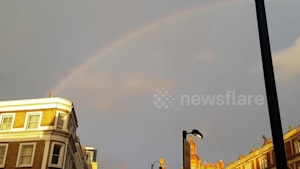 Beautiful rainbow adorns London skies