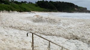 Man Bathes In Foam Waves During Cyclone