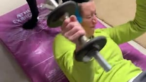 Dog interrupts woman's workout routine