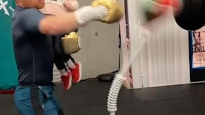 Boxing champ holds his daughter while training