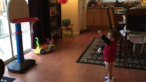 Toddler giggles every time he makes a basket