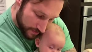 Dad uses his beard to put the baby to sleep