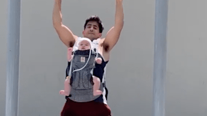 6-month-old baby does pull-ups with her dad