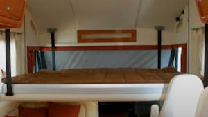 Raisable RV bed gives more room in main cabin