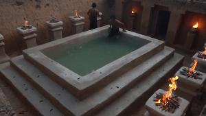 Craftsmen construct mini mansion with handmade pool