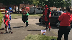 Superheroes bring cheer to children in the United Kingdom