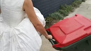 Woman Wearing Wedding Dress Drags Trash bin Outside House on her Anniversary During Quarantine