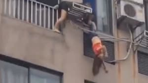 Neighbors rescue woman hanging upside down from seventh-floor laundry rack