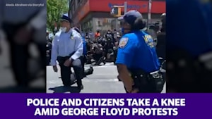 Some police and citizens take a knee amid George Floyd riots