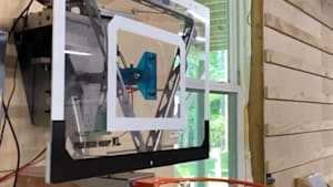 Tilting robotic basketball hoop helps you make every shot