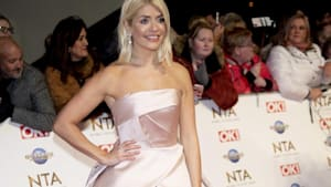 Holly Cowell! Holly Willoughby's father looks identical to Simon Cowell in throwback photo