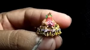 Indian miniaturist carves millimetre-tall wooden chariot