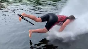 Professional water skier does push-ups on water
