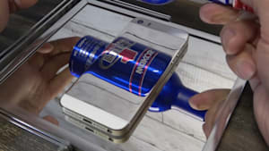 Artist from Japan polishes his iPhone to make it reflective
