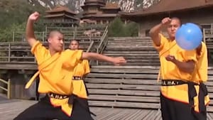 Even glass can't stop these Shaolin monks' needle throws