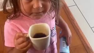 Kid tastes mom's coffee, immediately spits it out
