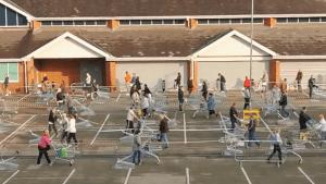 Massive social-distancing line forms at supermarket