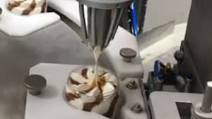 Machine that fills jars with ice cream will leave your mouth watering