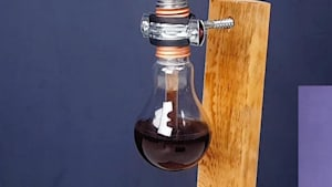 Inventive craftsman recycles light bulb into homemade coffee maker