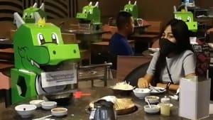Restaurant fills empty seats with dinosaurs