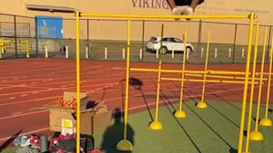 Track athletes effortlessly clears 61-inch hurdle