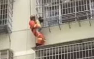 Chinese firefighters rescue five-year-old dangling from building