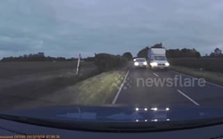 UK truck driver swerves off road to avoid head-on collision