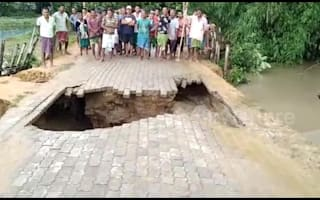 Road collapses in front of Indian villagers