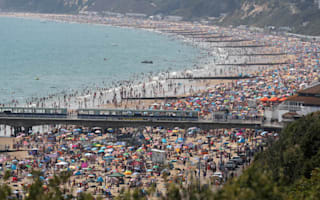 Storm warning as temperatures soar on UK's third hottest day on record