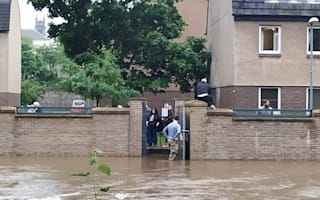 Boat rescue for 14 people at flood-hit rugby club